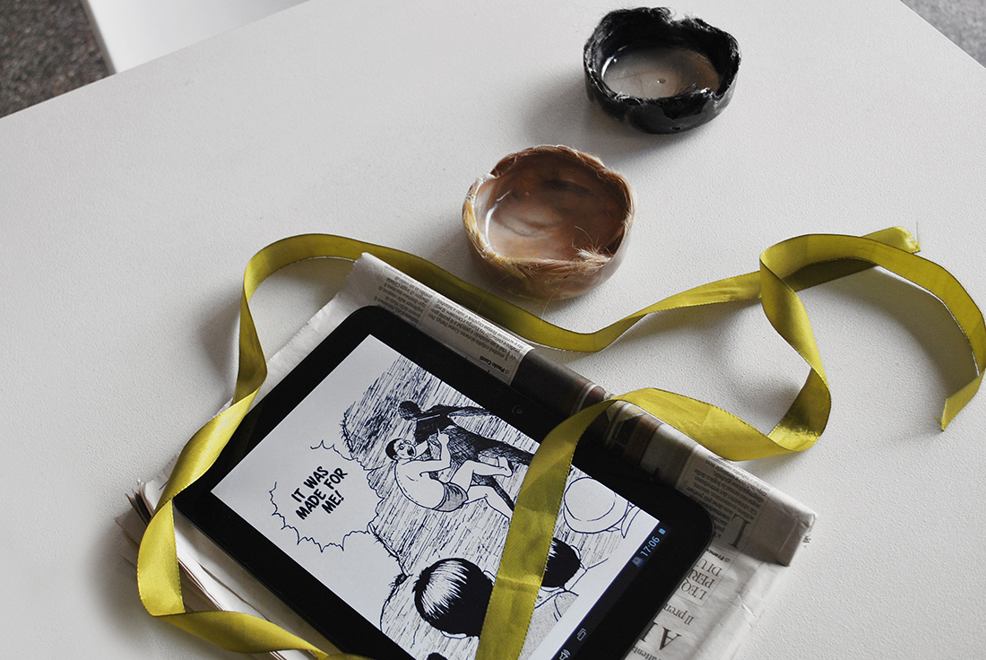 """LUCY CHINEN """"Chara-moe and transactional knowledge production - essay""""  2015 PDF on iPad, ribbon + LUCIA LEUCI """"Ashtray"""", 2016 Resin, synthetic hair"""